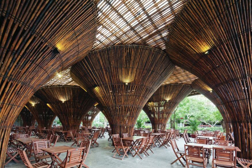 For the restaurant's nontraditional support structure, Vo Trong Nghia Architects leveraged the mechanical properties of bamboo to create inverted conical columns, which were mocked up and load tested prior to the project's construction.