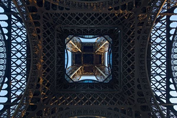 The renovation of the Eiffel Tower's first floor includes a glass floor along the inside perimeter, a feature that has become a crowd favorite.