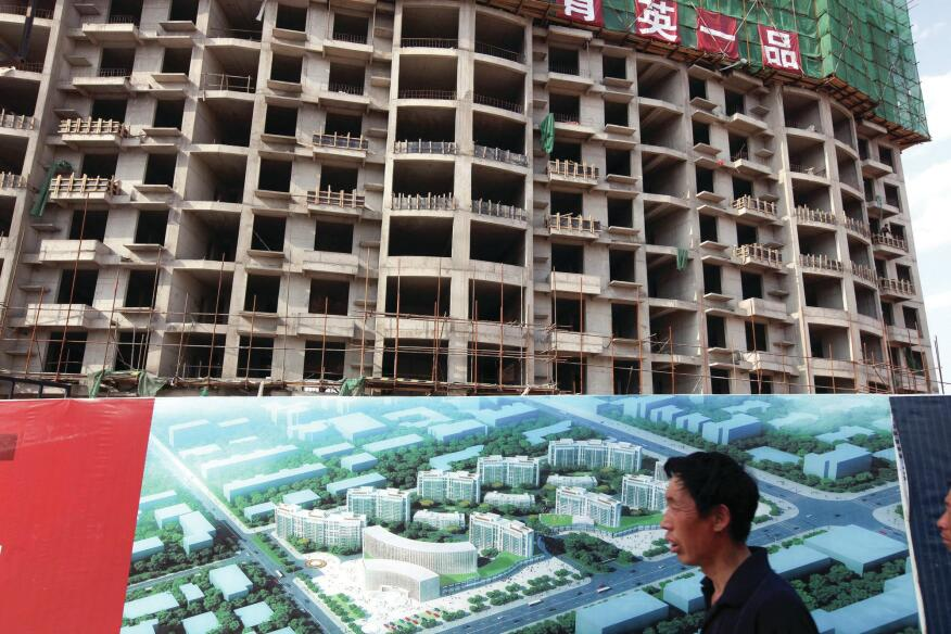 Apartment buildings under construction in the Kangbashi district of Ordos, one of China's notorious ghost cities.
