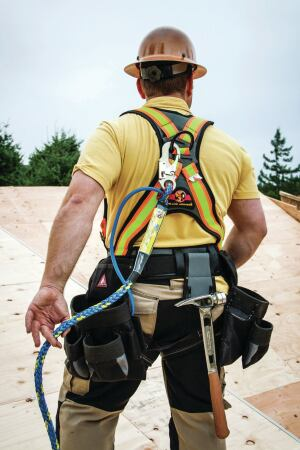 A 1/4-inch hose runs through the center of a braided line and comes out at a snap clip that can be attached to the tradesman's harness (as shown here) or to the building.