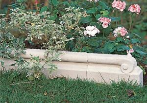 Scrolled edging stone  Haddonstone  www.haddonstone.com  Solid stone construction edging  Subtle scroll design on the front, flat on the back  Four components available, including a straight-run piece, left and right end pieces, and an edging post
