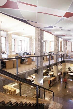 The first-floor cutout allows light to penetrate the basement-level office area, where full staff meetings and occasional office parties are held.