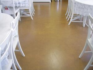Metallic oxide pigmented acrylic water-based stain was used on this commercial floor.