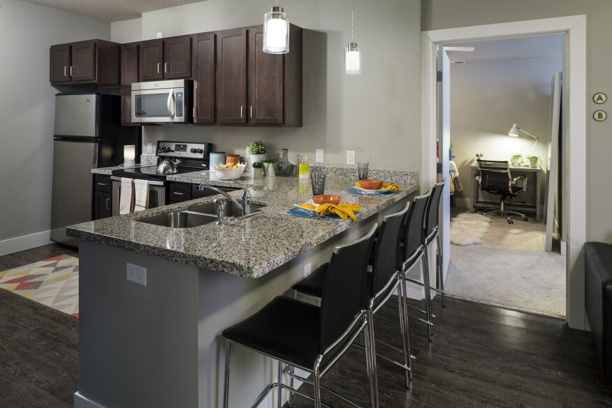 Residents of Fountain Residential's Metro Park East in Minneapolis are provided with a fully equipped kitchen.