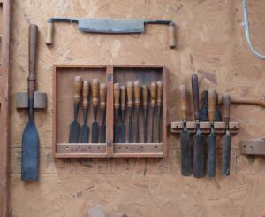 These tools once belonged to Marc Kunkel's great-grandfather, who was a barn builder. The oversize chisel on the left is a slick; it would have come in handy for timber-framing, the kind of construction once used to build barns.
