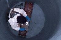 Hybrid epoxy manhole lining system