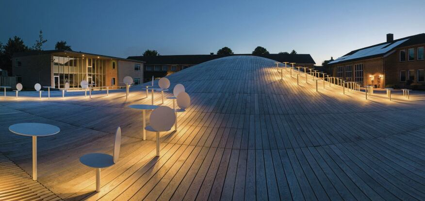 Lighting integrated into the rooftop furniture allows the courtyard's utility to extend beyond sunset.