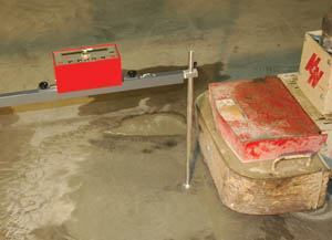 Measuring ground depth with a 6-foot wing-arm jig mounting a D-Meter.