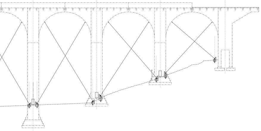 A section through one end of the site illustrates the steep terrain conditions and the different fixture locations required to create the proper aiming angles to illuminate the bridge arches.