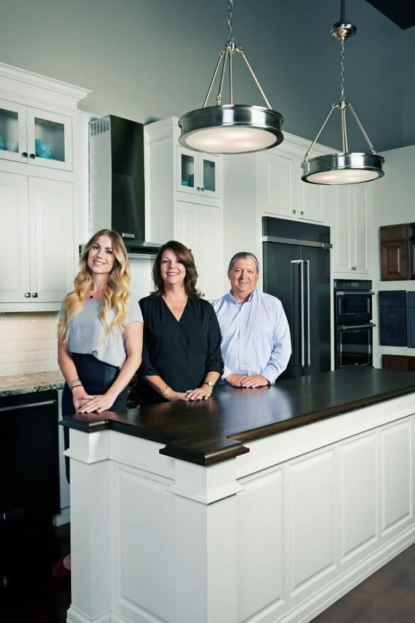 Integrated Marketing Director Celia Vrnak (left), VP Cabinet Sales & Showroom Designer Kitty Decareaux, and Austin Division President Paul Marshall worked together to create the new showroom.