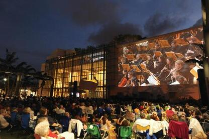 A 7,000-square-foot projection wall in a park adjacent to the building streams musical performance from the auditorium.