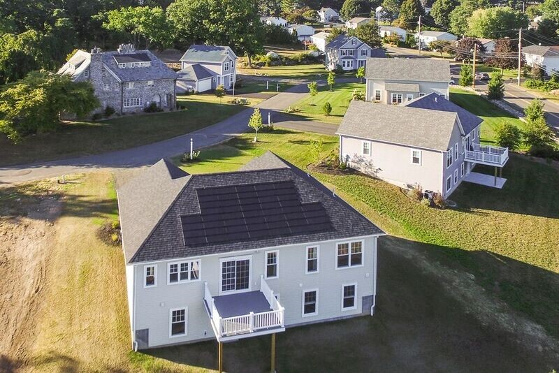 An overhead view of Brookside Development's Singer Village community. The Historic Singer Home is visible in the upper left.