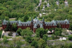 Once St. Vincent's Sanitarium, the historic property continues today as affordable housing after a $27.3 million acquisition and rehabilitation.