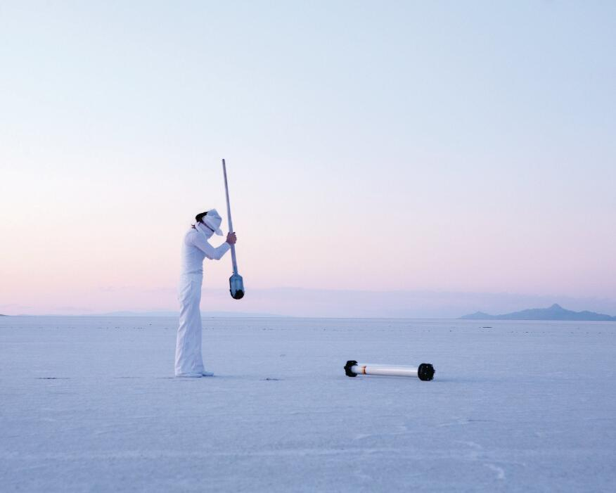"""In an image from """"The Gray Rush,"""" Benjamin's Nevada Art Museum exhibit, a prospector tests salt flats for lithium, used in cellphone and laptop batteries. The exhibit explores issues of global resources and technology."""
