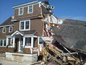 The intact addition shown above withstood Sandy's storm surge on the beach at Mantaloking, N.J. The original house was undermined by scouring and collapsed.