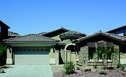 SAUVIGNON BANK: The 2,314-square-foot Sauvignon model brings in sales at Mountain's Edge with its ability to flex to five bedrooms. The house has a two-car garage and an optional courtyard fireplace.