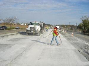 A worker prepares to seal a pavement joint on a test section of state Route 59 near Joliet, Ill.