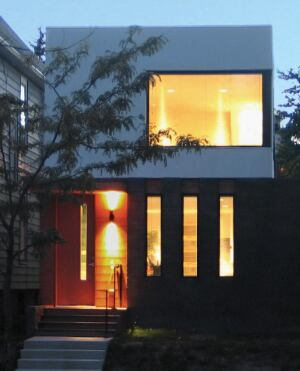 """clear value When the budget permits, JSA specs high-end Starphire ultra-clear glass, which it used for the large picture window in this urban infill project. """"It's a low-iron glass that costs about twice as much as regular window glass but is extremely tr"""