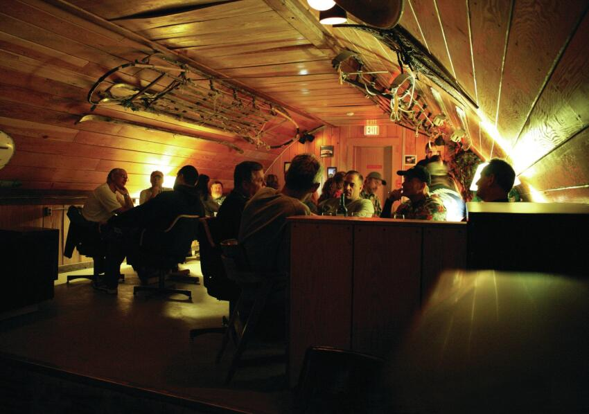 Scientists gather at McMurdo's wood-paneled coffee house, which also doubles as a wine bar.