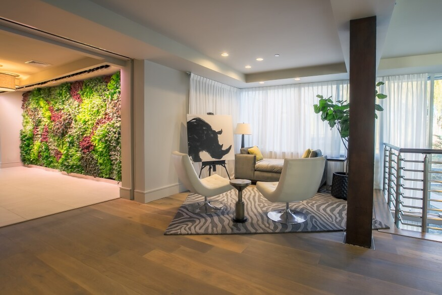 The Living Green Wall connects the building's lobby with the amenity spaces.