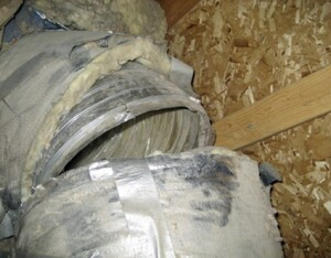 Leaky ducts create problems with backdrafting and lead to heat loss. (Photo: Ryan Meres)