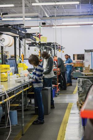 Lumenpulse's final assembly operations in Montreal rely on a flexible supply chain and manufacturing facility to meet the ever-changing digital world. The high number of electronics in LED luminaires requires dexterity on the part of trained technicians.