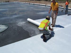 An absorbent curing cover can be rolled or squeegeed nearly wrinkle-free. When applied flat, these materials provide a more consistent cure across the slab surface, resulting in less discoloration.