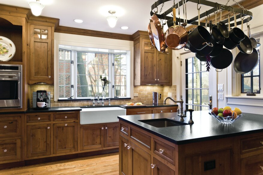 Room for Two: Alder cabinets, honed granite countertops, and a tumbled marble backsplash give this kitchen a rustic feel.