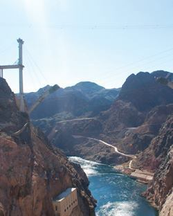 From the Hoover Dam Visitors Center, you can see the cast-in-place arches of the Colorado River Bridge taking shape downstream.