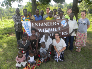 Tufts University: Travel Team with members of the Water Board and children of the community.