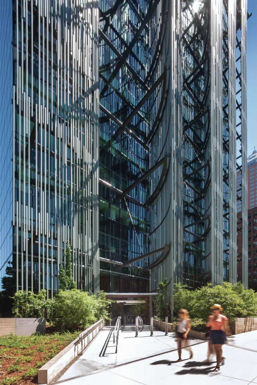 """The aluminum """"reeds"""" on the west façade are attached to a steel structure that shades the curtainwall to mitigate heat gain. Vegetation is being trained to grow around the frame to the height of the third floor."""