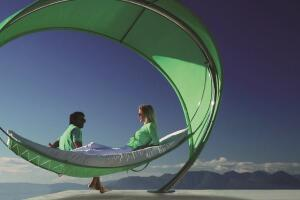 Royal Botania's striking Wave is an elliptical, canopied hammock measuring 12' by 9-1/2' by 8'. Made of electro-polished stainless steel with perforated, semi-transparent fabric, the Wave was designed by Erik Nyber and Gustav Stršm and is suitable for hospitality environments. It rests on one slender support, and the fabric blocks 86% of the sun's rays.royalbotania.com