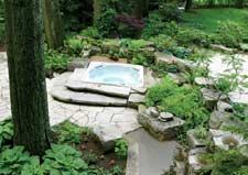 The Canvas:An enchanted forest of cedar and pine, tiny space, tricky accessThe Palette: Flagstone patio, geometric pond, cascading waterfallThe Masterpiece: A secret stone garden, nature's balm for the weary soul
