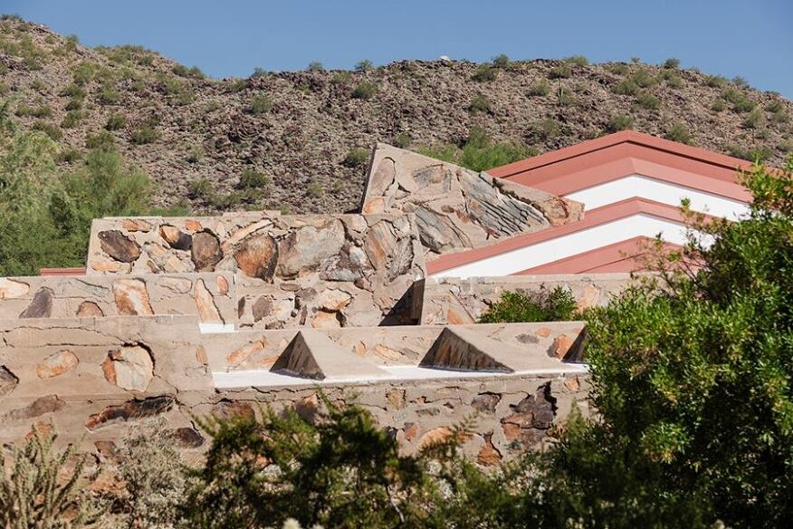 "Taliesin West's ""desert masonry"" exemplifies Wright's organic-design ideal while its slanted rooflines echo the surrounding mountains."