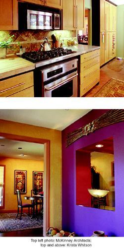 For big effects, McKinney Architects relied on small moves, such as partially enclosing the entry hall (above) and rearranging the kitchen (top). Bold interior paint color choices also paid handsome dividends.