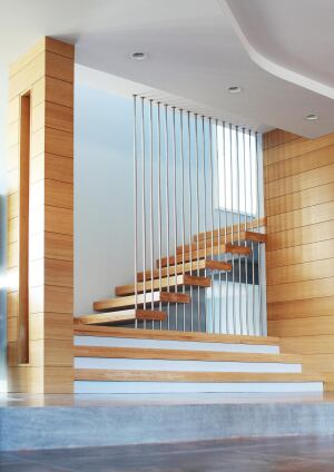 Stainless steel rods provide deceptively solid support for a stair that seems to float in space.