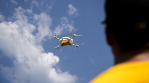 Amazon's video shows drones on a delivery mission.