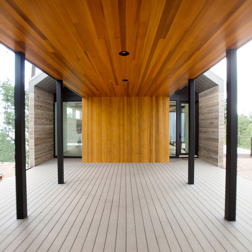 Tomecek Studio employed modular design and prefabrication to expedite construction of the main residence of the Black Hills Homestead, which is connected to a barn via a vertical-grain cedar breezeway.