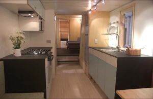 The modest miniHome features a rainscreen cladding of Richlite paper-based siding, Galvalume, or cedar; Ikea cabinets, rubber floors, and low-VOC water-based finishes jazz up the interior.