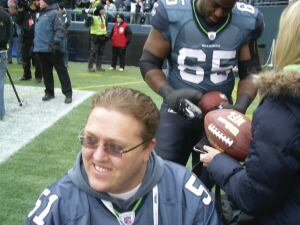 "Megafan: In addition to his financial-adviser career, recent marriage and work with the Brain Injury Alliance of Washington, Meneely is an avid fan of local teams, including the 2013 Superbowl Champion Seattle Seahawks. ""So last year was a really good year for us celebrating the Seahawks,"" he said."