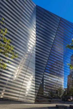 Alternating bands of reflective and matte-finish steel clad the entry pavilion's exterior.