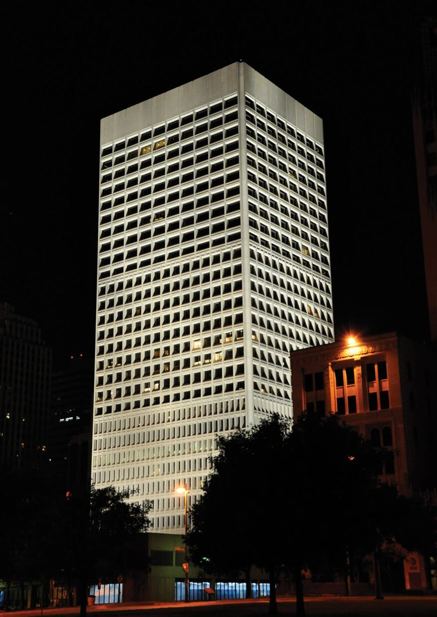 The 30-story office tower lit at night. It was designed in 1971 by architect Pietro Belluschi in the Brutalist architectural style.