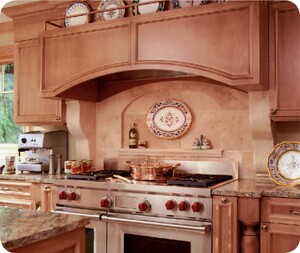 Designer Nicole Truesdell says this cooking niche is a real workhorse, with everything in reach. Pots and pans are stored in the island across from the niche, there is preparation space on both sides of the range, and on either side of the stove are pull-outs to hold spices and oils. The corbels under the arched rangehood are made of solid pieces of travertine that match the backsplash.