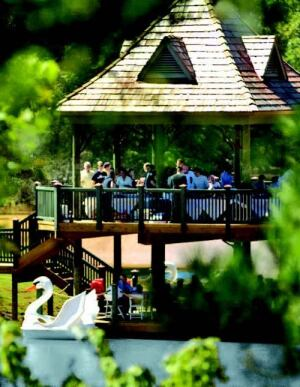 """SWAN LAKE: """"Soft programming"""" allows prospective buyers to sample the lifestyle of a community for an afternoon. This party on a bandstand and boat dock near Atlanta is one such example."""