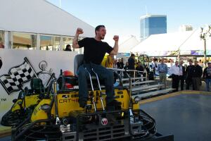 Stu Angeli, winner of Wacker Neuson's 2011 TROWEL CHALLENGETM competition at the World of Concrete, celebrates his victory on a new customized CRT 48-35VX ride-on trowel powered by a special VanguardTM BIG BLOCKTM V-twin engine.