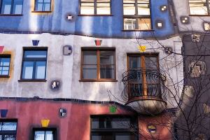 Hundertwasser-Krawinahaus • Location: Vienna • Developers: Joseph Krawina and Peter Pelikan • Architects: Friedensreich Hundertwasser and Joseph Krawina • Built: 1983 to 1986 • Units: 52 • Notable: More than 250 trees and bushes flourish at the property, which is one of Vienna's most visited buildings. The property also includes 16 private terraces and three communal terraces.