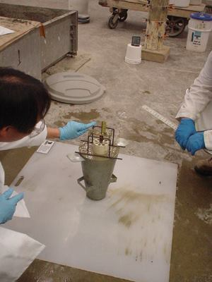 Researchers perform a penetration test with an inverted slump cone.
