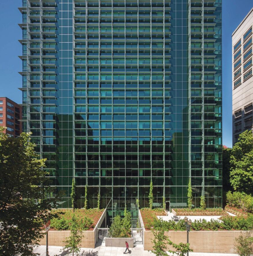 Visitors to the Edith Green–Wendell Wyatt Federal Building enter a double-height lower-level lobby through landscaping that hides the elevation change between the north façade (shown) and south façade.