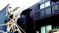 Structural damage, such as that suffered by this condominium roof, is often the result of inadequate attention to fasteners and other construction details, according to a preliminary report on Hurricane Katrina.