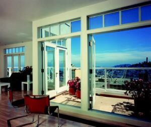 BAY SIDE: All three units that make up 1055 Lombard Street (above) in San Francisco, the Project of the Year in 1987, are afforded dramatic views of the city and bay beyond thanks to horizontal bands of windows and glass doors kept in scale by a ribbon of clever clerestory units.